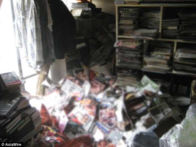 The huge pile of pornographic magazines under which the man was found dead after months