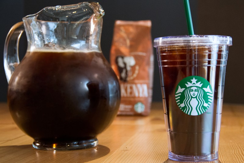 Pitcher & Starbucks cup filled with Starbucks iced coffee near bag of Kenya coffee blend
