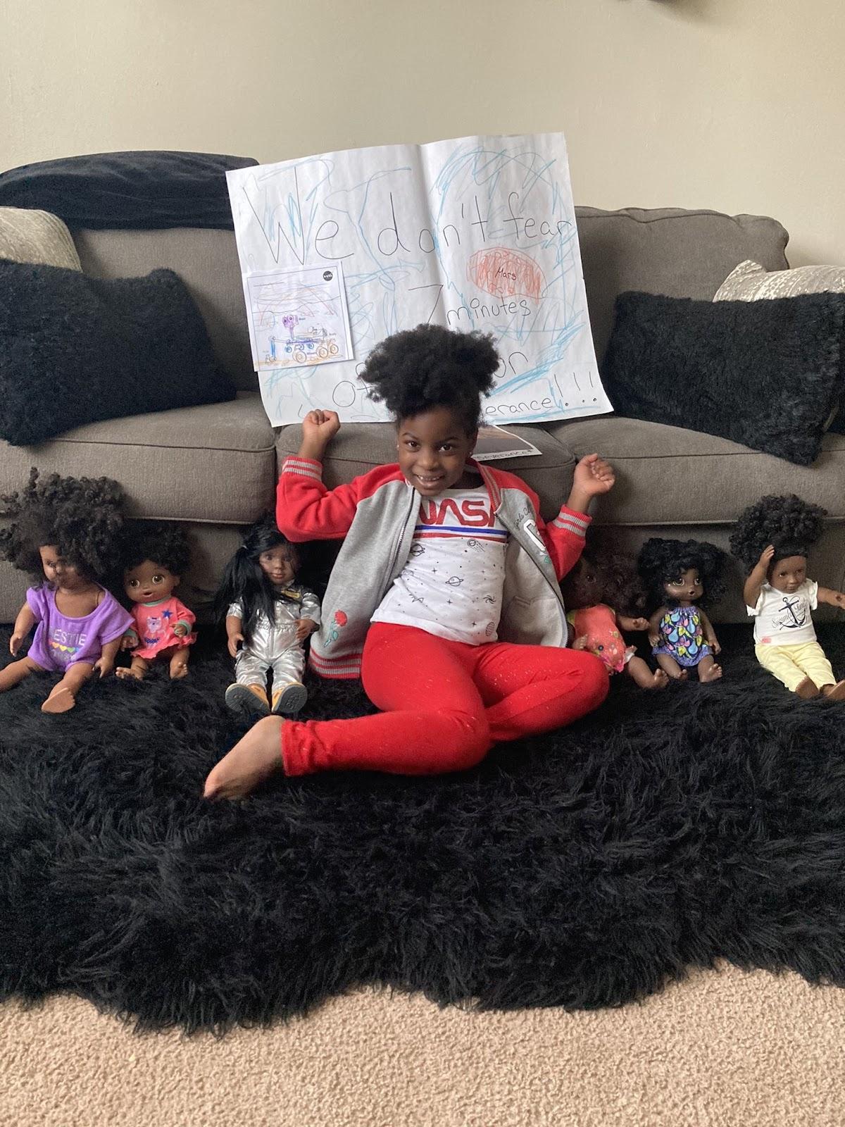 Ryan with Black girl dolls.