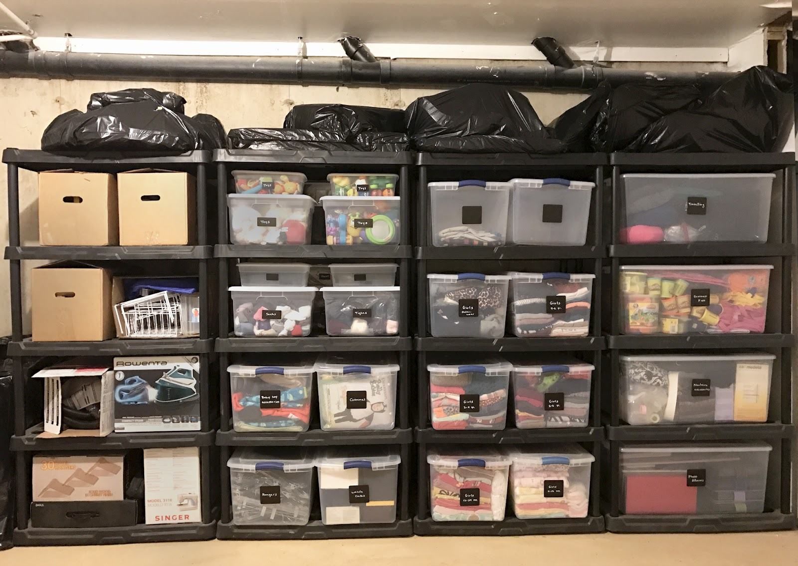 Wall of organizers in a home basement