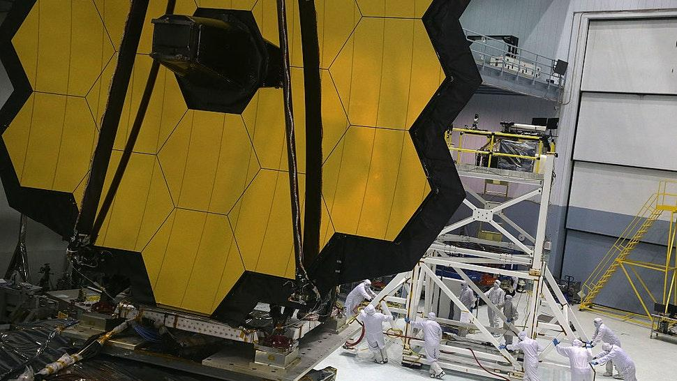 GREENBELT, MD - NOVEMBER 02: Engineers and technicians assemble the James Webb Space Telescope November 2, 2016 at NASA's Goddard Space Flight Center in Greenbelt, Maryland. The telescope, designed to be a large space-based observatory optimized for infrared wavelengths, will be the successor to the Hubble Space Telescope and the Spitzer Space Telescope. It is scheduled to be launched in October 2018. (Photo by Alex Wong/Getty Images)