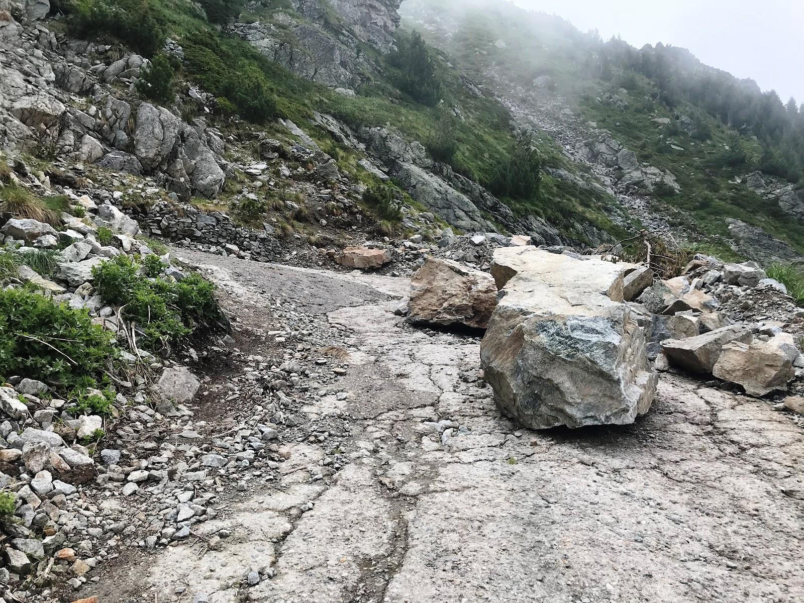 Rocks on road on Rila bike climb