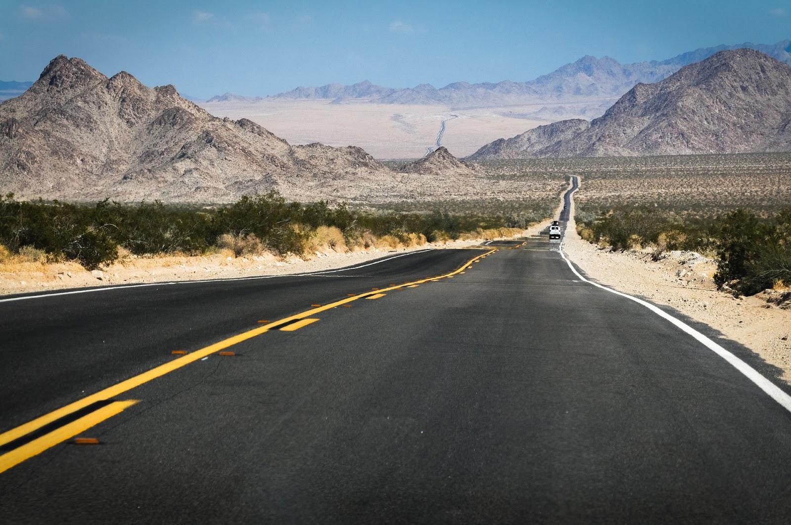 1 van single car on long route 66 in arizona in rural country desert and hills