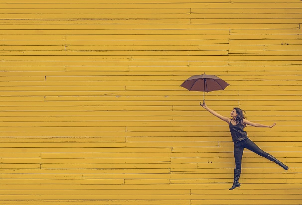 whimsical person with umbrella