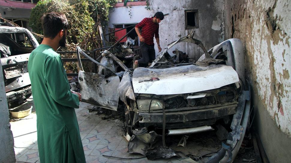 """Photo taken on Sept. 2, 2021 shows damaged vehicles at the site of the U.S. airstrike in Kabul, capital of Afghanistan. TO GO WITH: """"Feature: Neighbor, relative of drone strike victims lambaste U.S. killing in Afghanistan."""