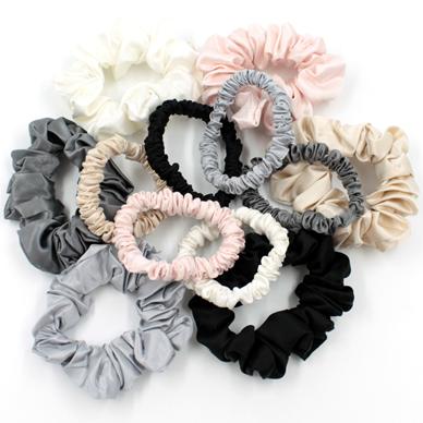 Charmeuse Silk Hair Scrunchies on a table