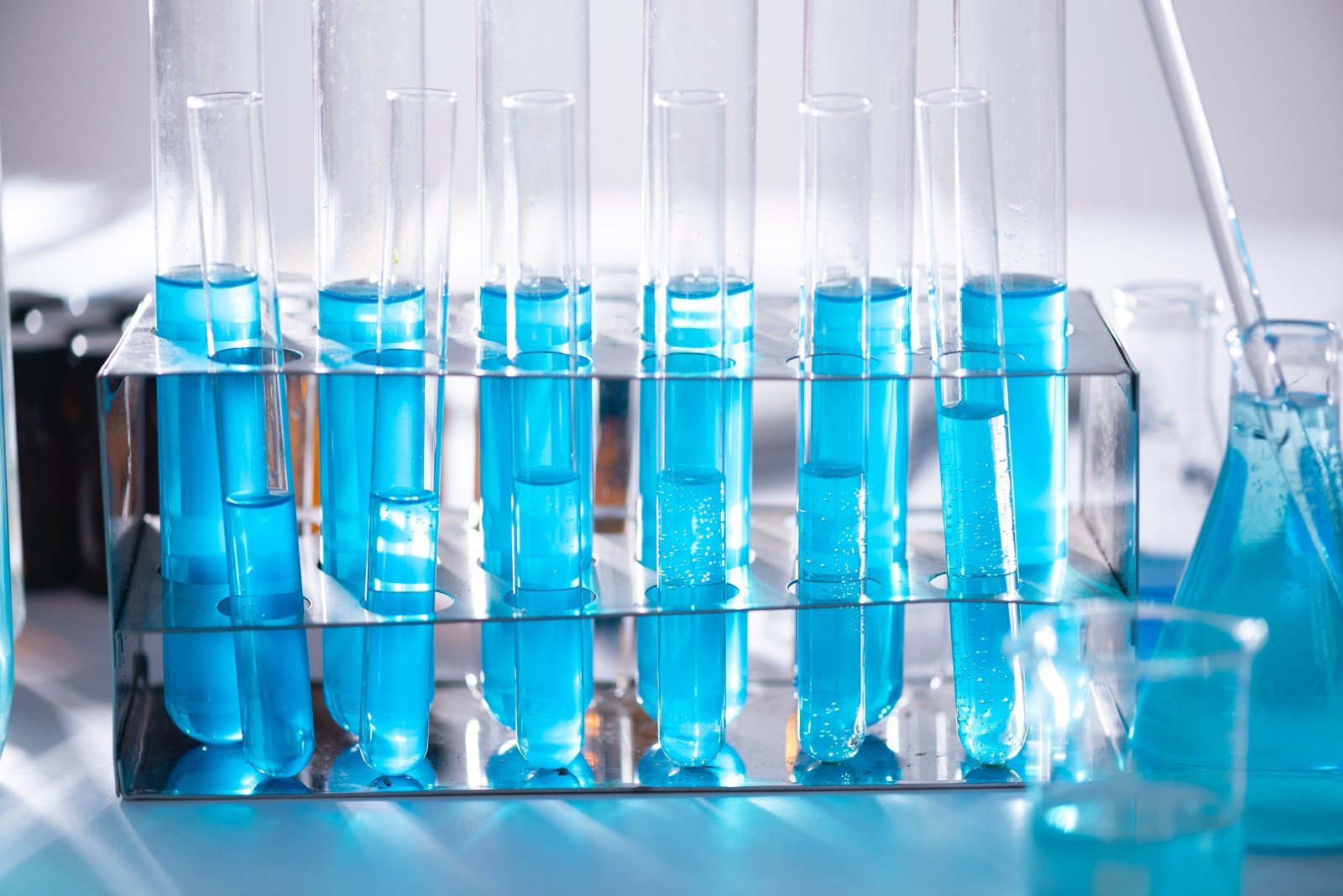 Test tubes filled with blue liquid