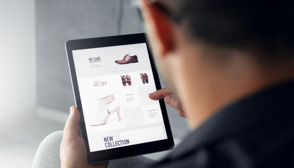 man looking at an ecommerce website