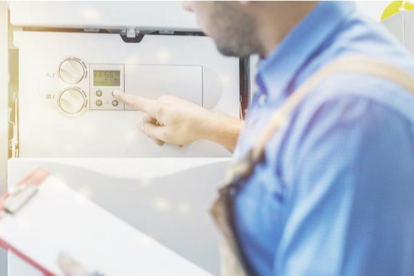 hvac technician installing water heater