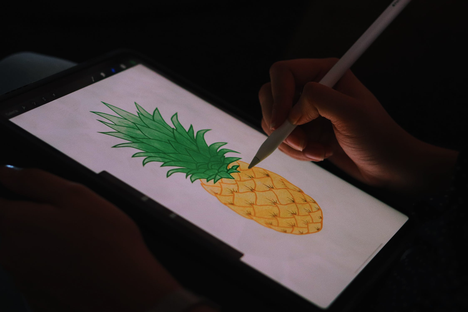 A person drawing on a tablet