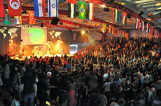 Missions Conference in the Gym with Flags