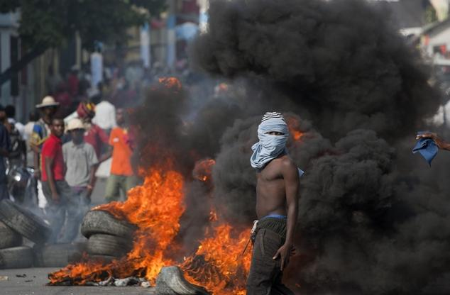 Haiti suspends fuel price hike after protesters riot- Added COMMENTARY By Haitian-Truth