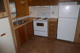 The interior kitchen of a mobile home unit