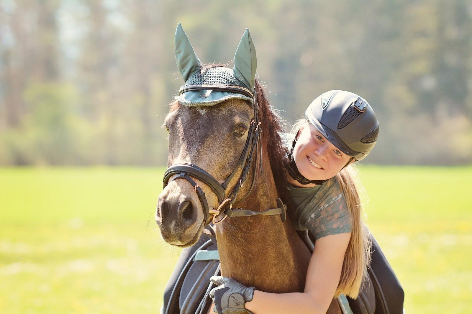 girl on horseback outside