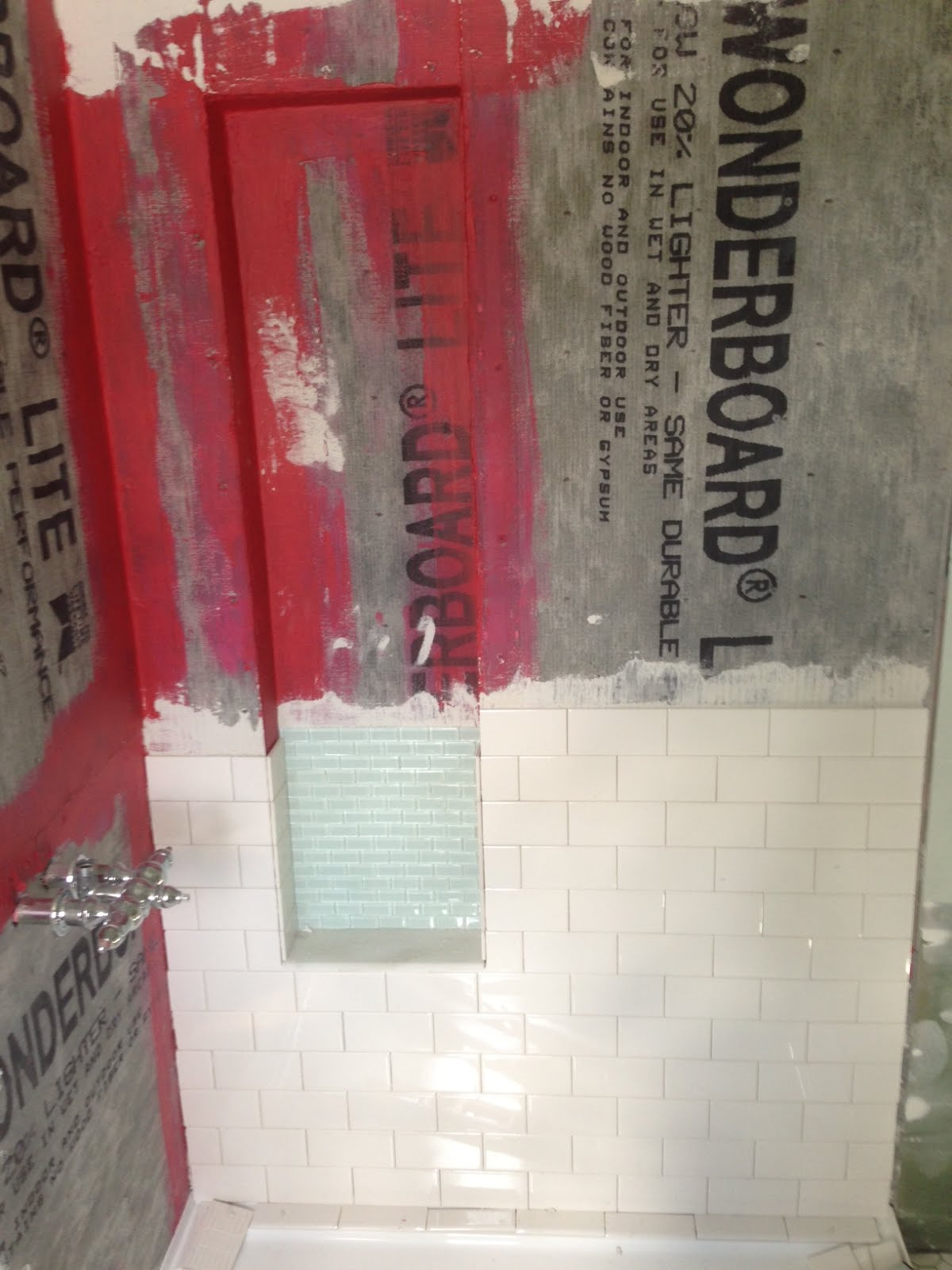 diy shower niche with glass mosaic and white subway tiles using Redgard waterproof membrane-www.goldenboysandme.com