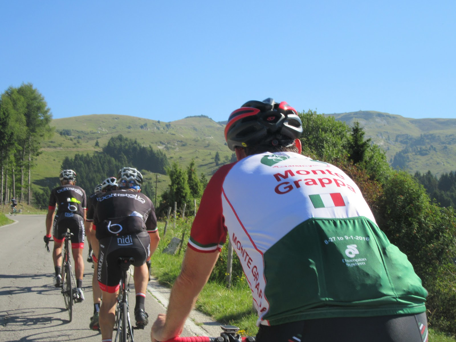 Cycling Monte Grappa from Romano d'Ezzilino - many cyclists on the road riding bikes, pjamm cycling