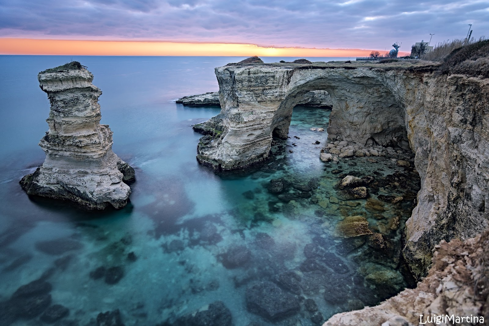 lecce seaside cliffs crystal clear sea during sunset. Lecce is a must on any Southern Italy road trip.