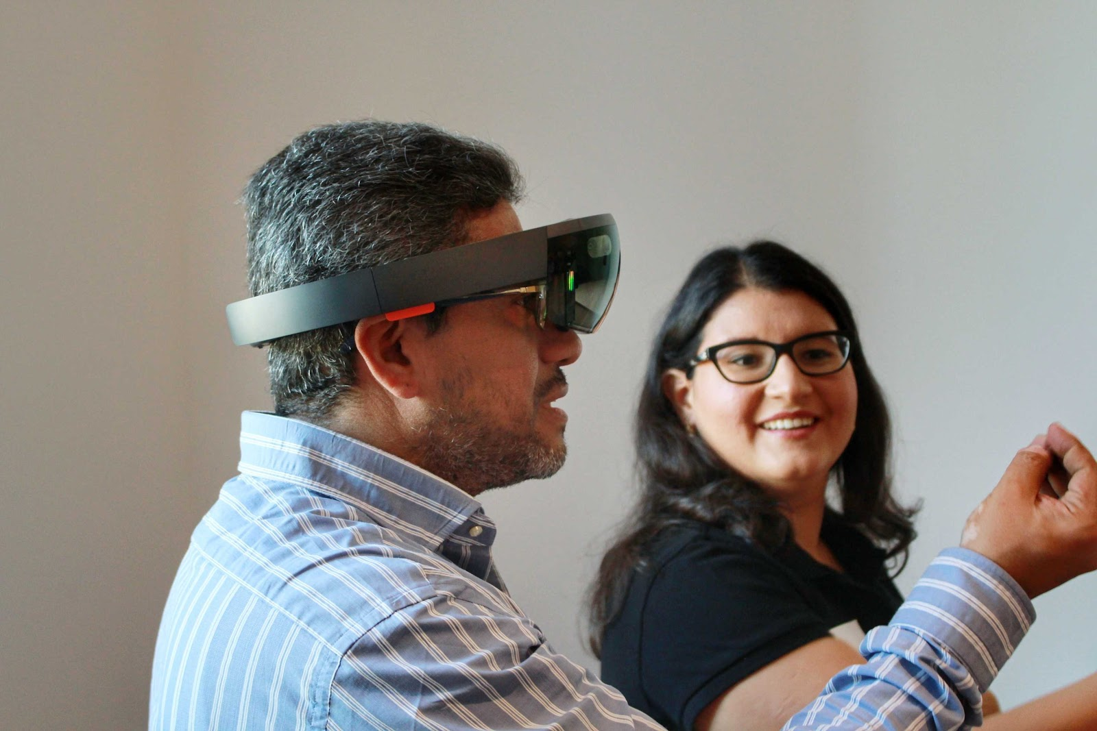augmented reality and museums: Workshop participant tries out HoloLens
