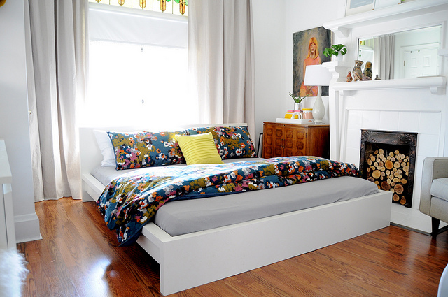 large bed in colourful bedroom.