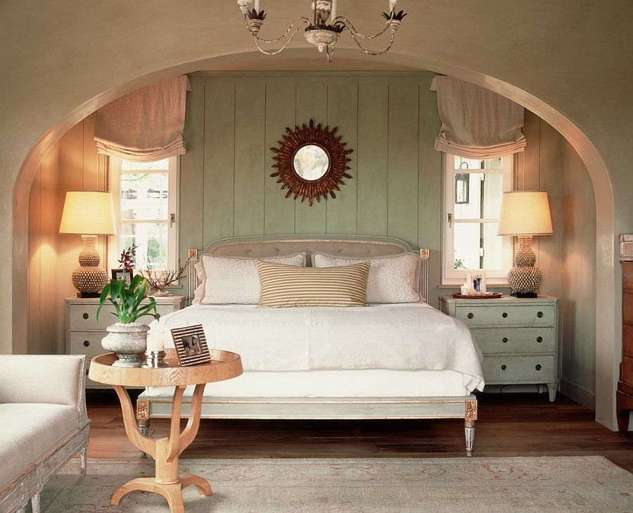 Bedroom with arch architecture, a pastel green pair of chic nightstand and backdrop