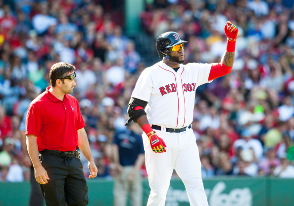 BOSTON, MA - AUGUST 23: David Ortiz #34 of the Boston Red Sox reacts just after he got hit by a pitch thrown by Charlie Furbush #41 of the Seattle Mariners during the sixth inning at Fenway Park on August 23, 2014 in Boston, Massachusetts. (Photo by Rich Gagnon/Getty Images)