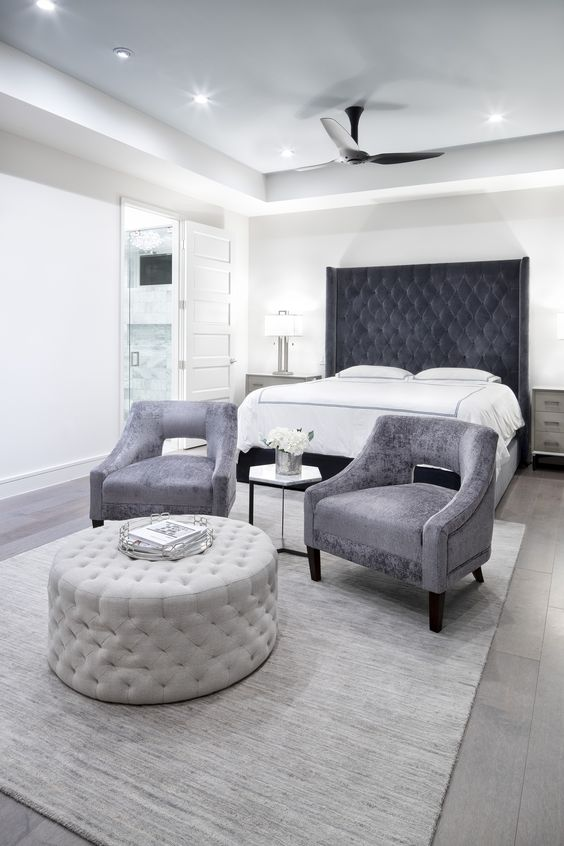 Traditional Master Bedroom with Velvet Lounge Chairs