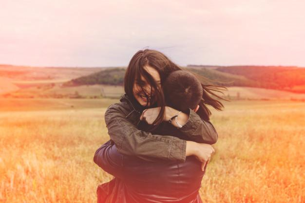 Landscape portrait of young beautiful stylish couple sensual and having fun outdoor Free Photo