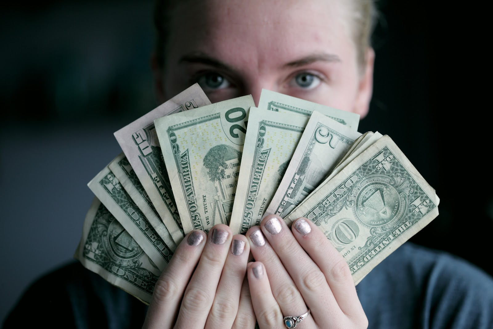 woman holding dollar bills