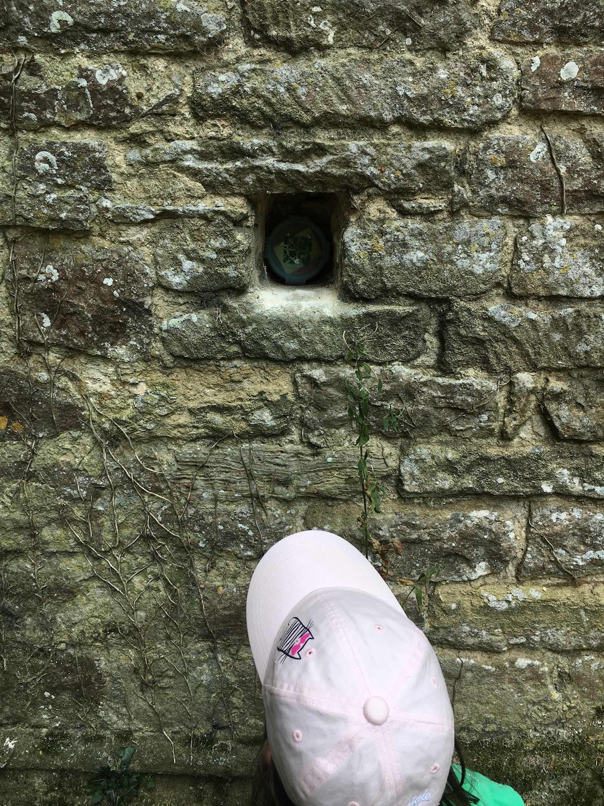 Small geocache hidden in a wall