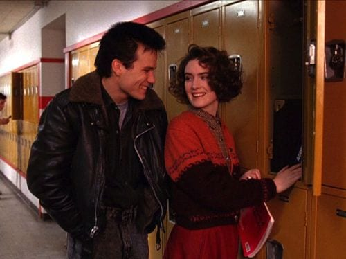 donna and james joke with each other at the school lockers