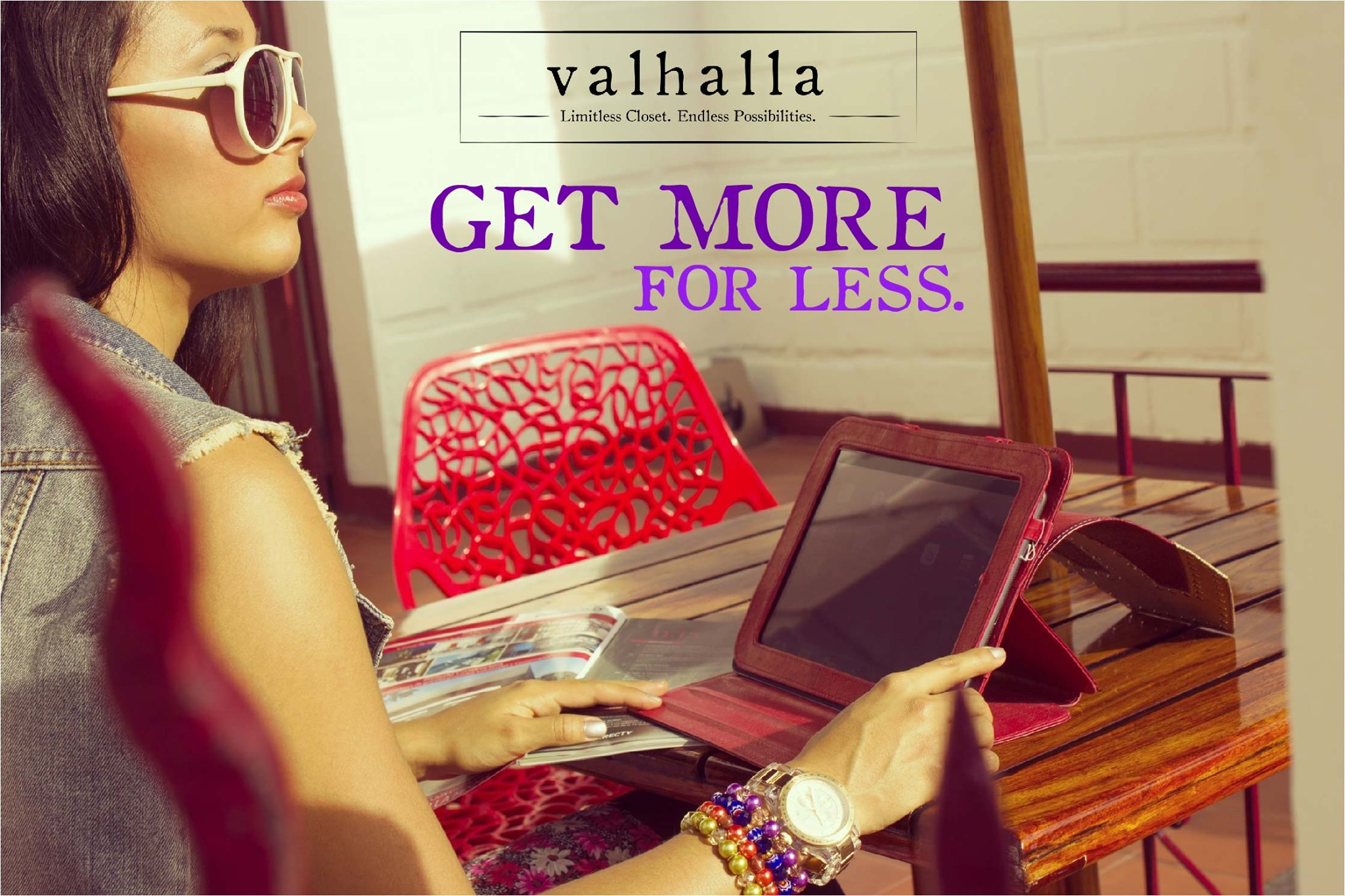 """Valhalla advertisement that features a stylish woman looking at an iPad and reads """"Get More for Less."""""""