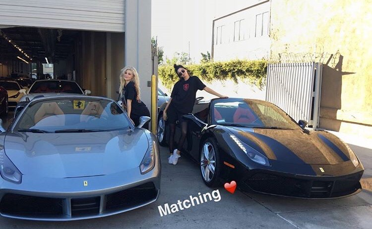 kylie and kendall posing with ferrari 488 spiders