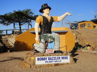 sculpture of the big miner kneeling with a pickaxe