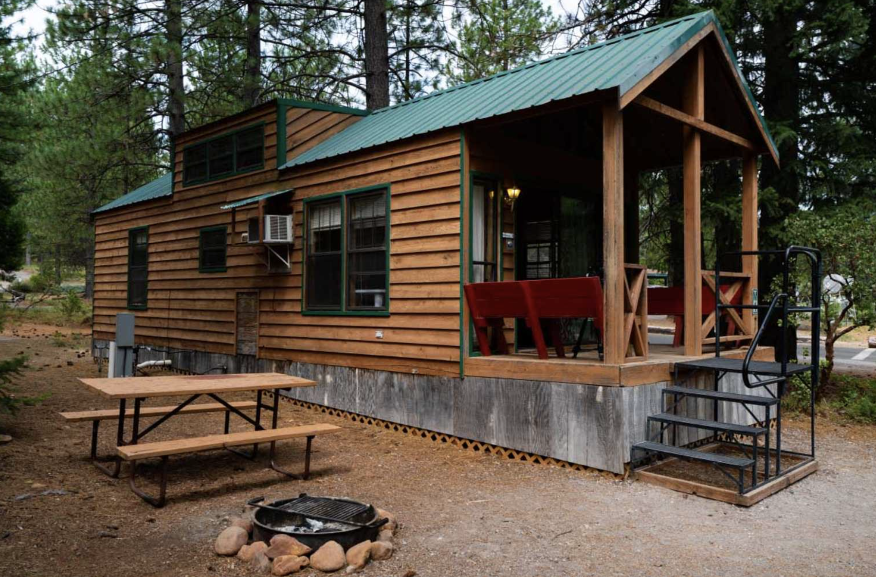 Cabin with picnic table and fire pit at campground