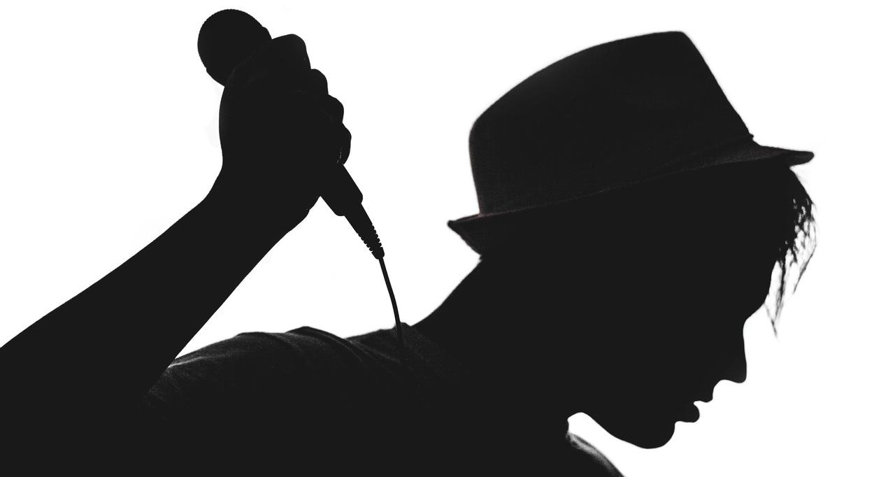 Pop artist with a microphone during performance
