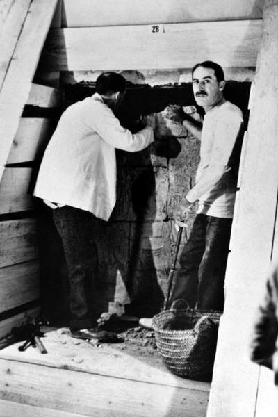 Image of HOWARD CARTER (1873-1939) English archaeologist. Carter (right) with Lord Carnarvon at the entrance to the inner chamber of Tutankhamen's tomb in the Valley of the Kings, Egypt, 1923, © Granger / Bridgeman Images