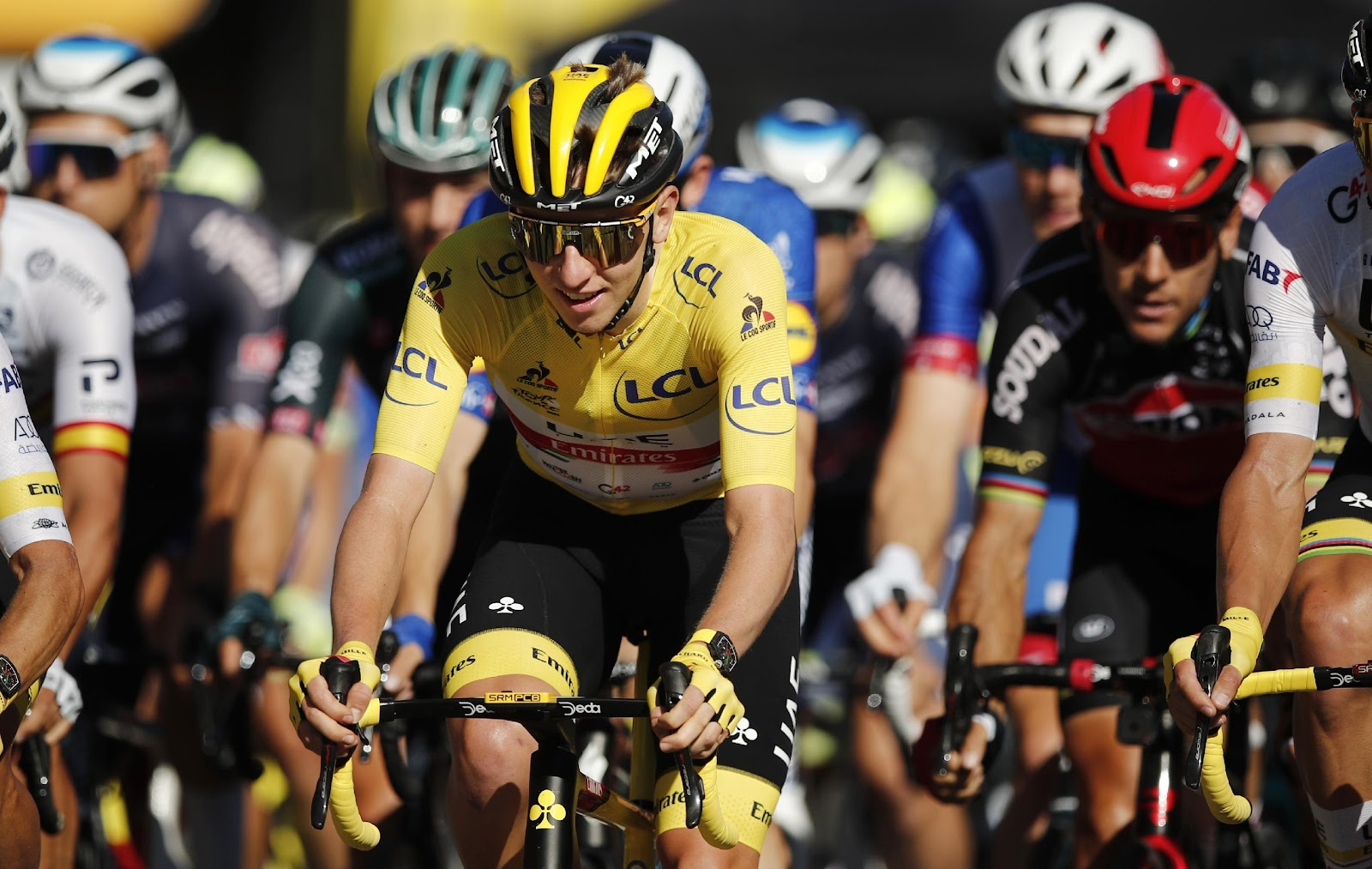 Cycling - Tour de France - Stage 21 - Chatou to Paris Champs-Elysees - France - July 18, 2021 UAE Team Emirates rider Tadej Pogacar of Slovenia wearing the yellow jersey in action during stage 21 Pool via REUTERS/Benoit Tessier