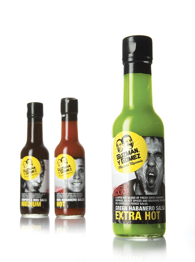 The Guzman Y Gomez sauce packaging designs feature real employees tasting the food product on the label