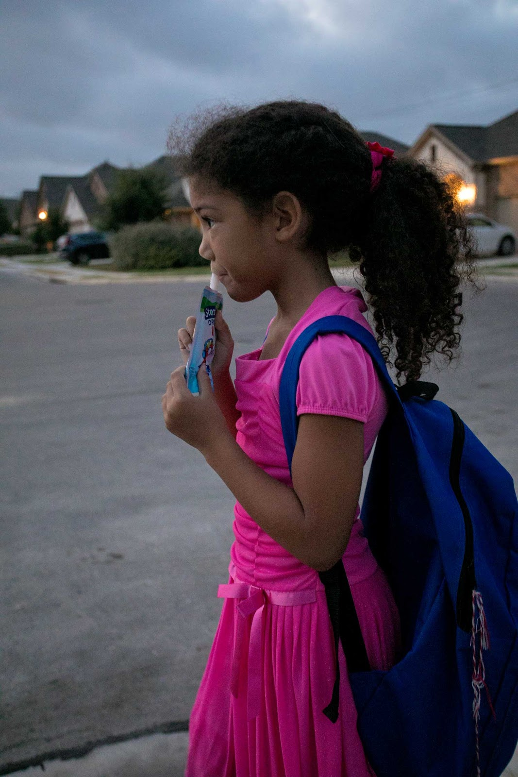 Little girl waiting for the bus. Our homeschool to public school transition.
