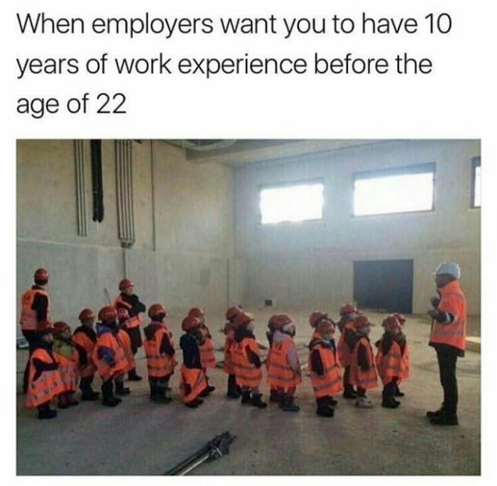 A group of kids in a factory listening to managers talking about how they want to hire experienced candidates
