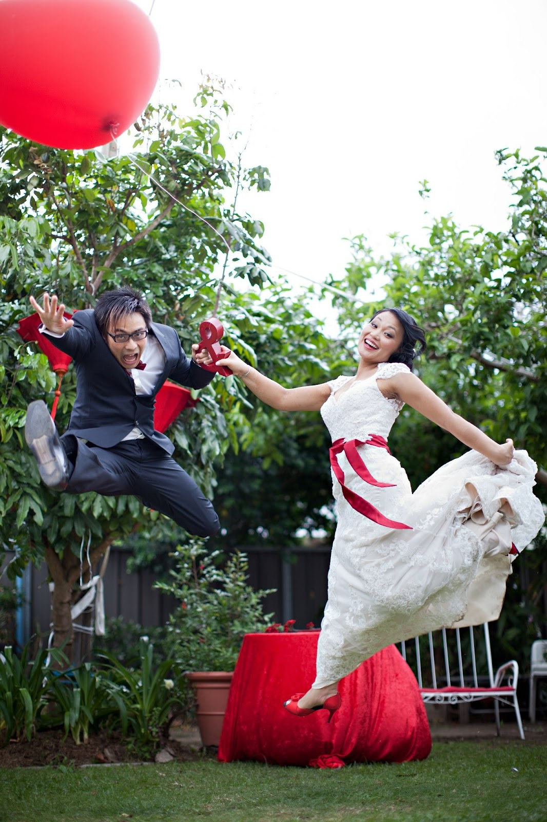jumping wedding shot with balloons.JPG
