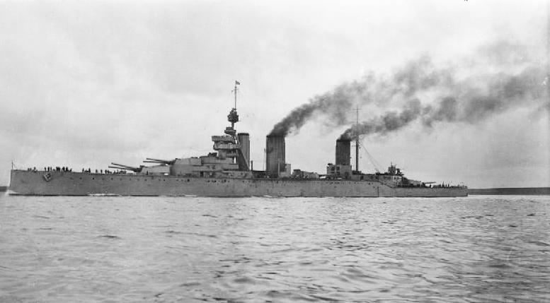 Three-stacked, dark grey warship at sea