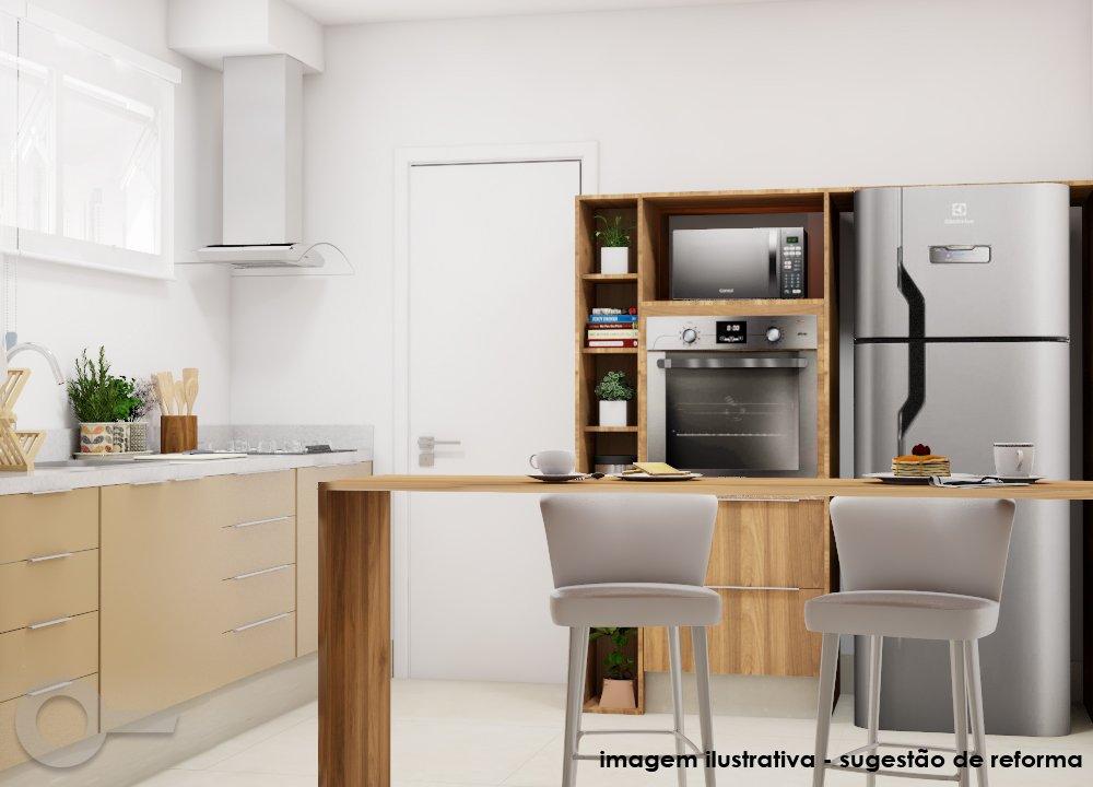 Exemplo de cozinha com ilha em apartamento na Bela Vista, em São Paulo