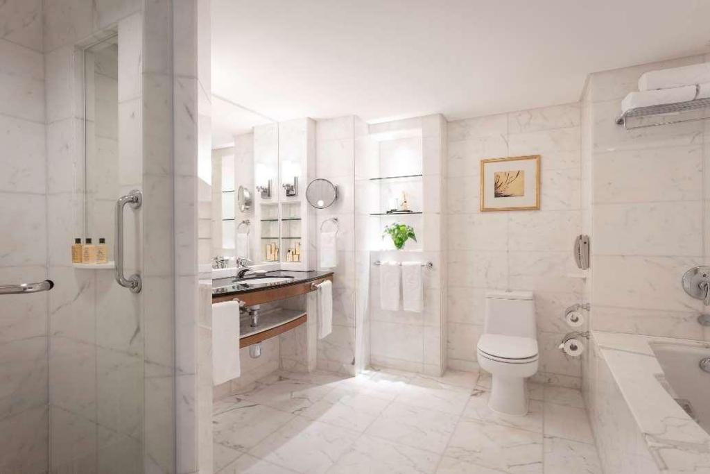 A Bathroom With A Sink Toilet And Bathtub  Description Automatically Generated With Medium Confidence