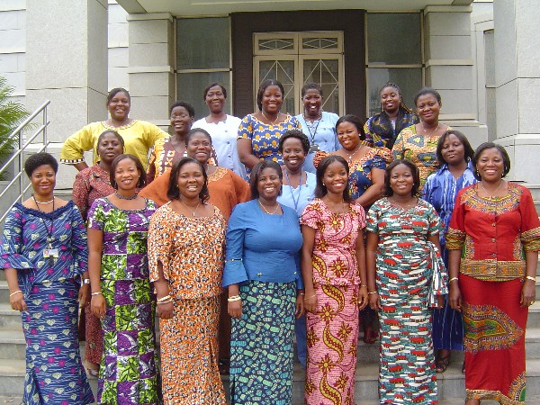 Black Mormon women standing outside a temple.