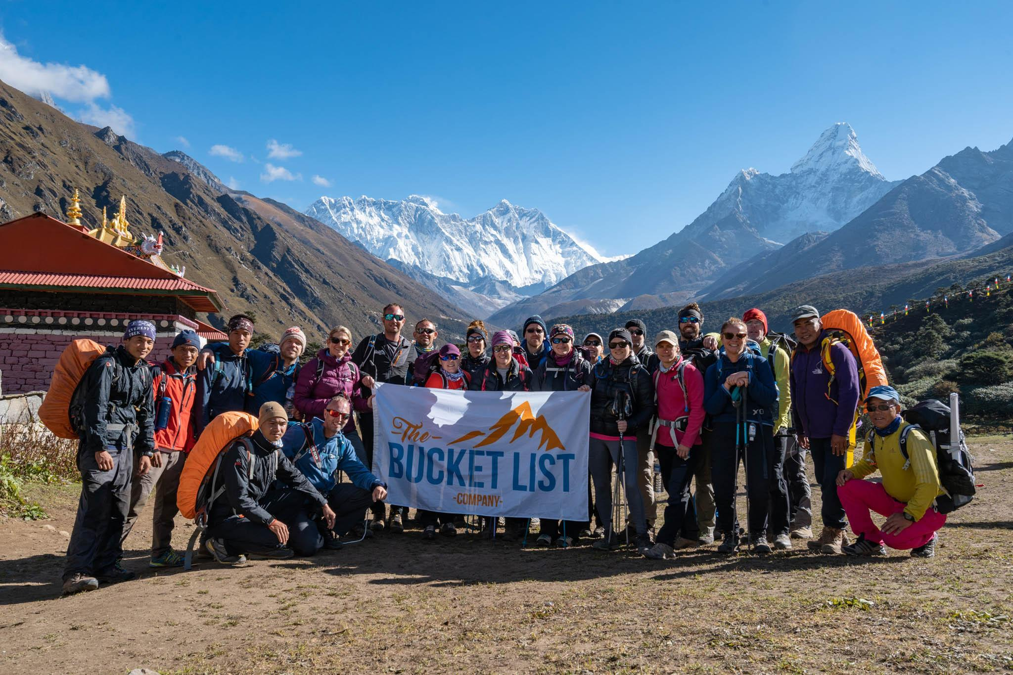 A group of The Bucket List Company trekkers with a view behind them