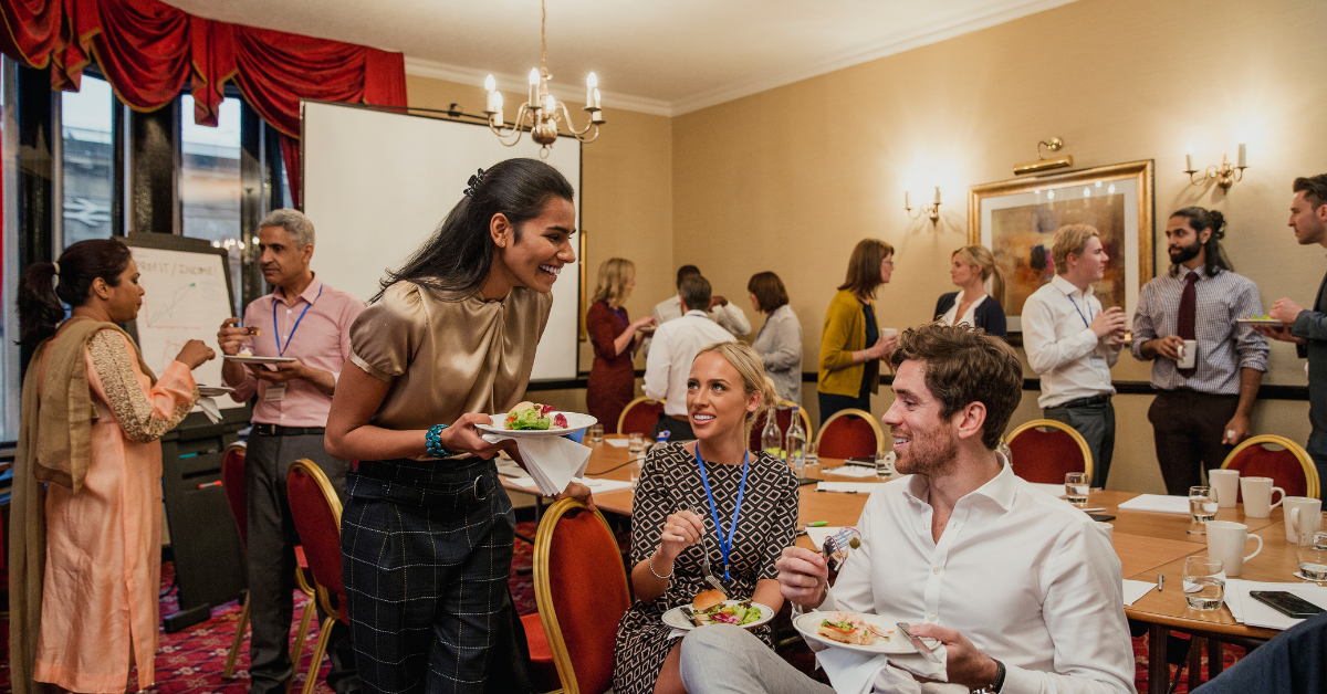 Woman networking with others at a conference during a lunch break