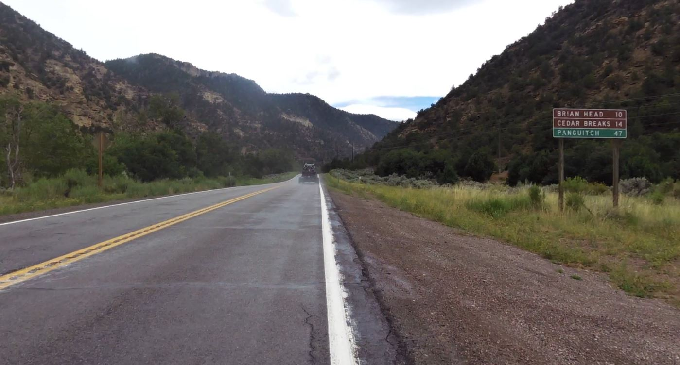 Climbing Hwy 143 by bike - start of climb - road and sign
