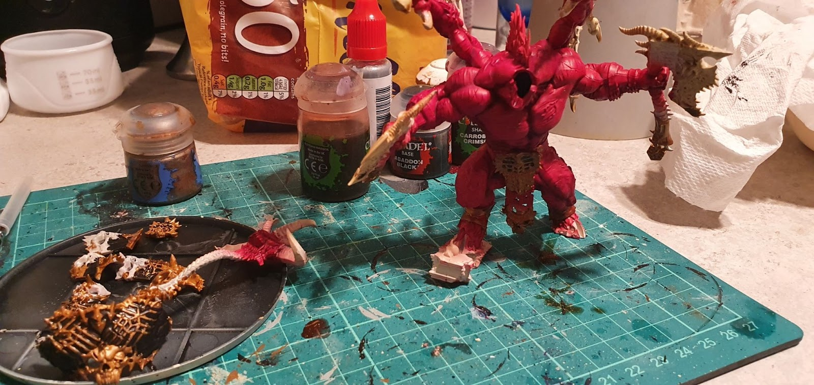 Headless and armourless Skarbrand, painted red.  The armour is at the side painted black and gold ready to attach.