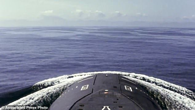 The submarine of the Russian navy is seen before a practice missile launch in the Sea of Okhotsk, Russia, on Saturday